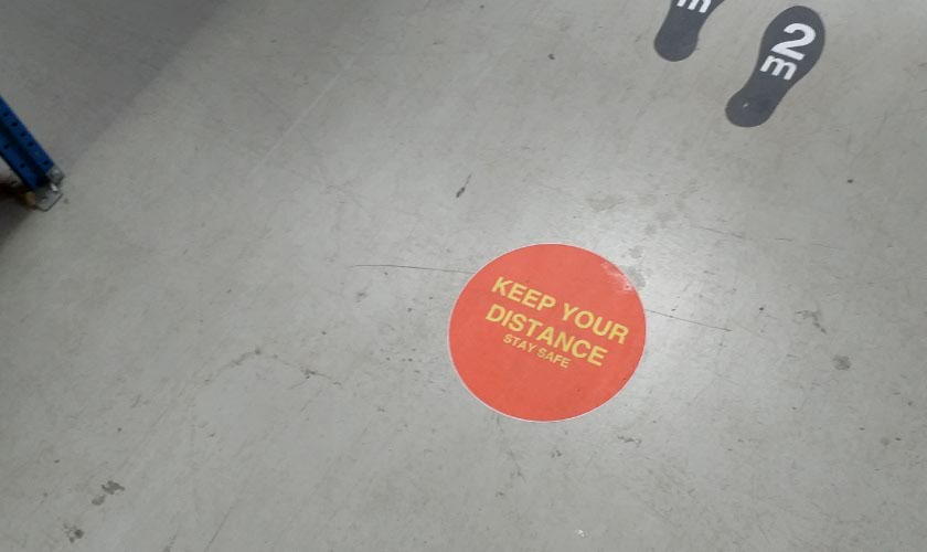 Red Keep Your Distance Sticker in use